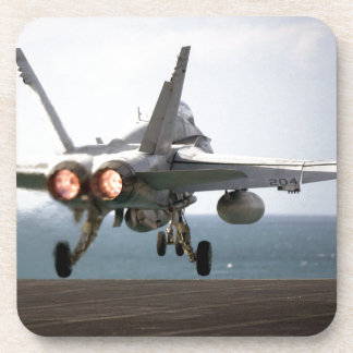 Military aircraft launching off aircraft carrier drink coasters