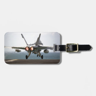 Military aircraft launching off aircraft carrier luggage tag