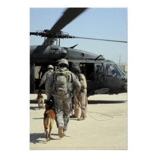 Military working dog handlers board a helicopte poster