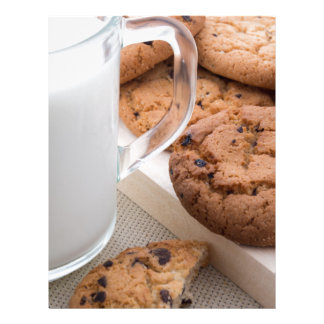 Milk and oatmeal cookies with chocolate letterhead