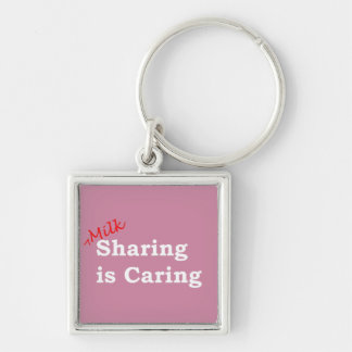 Milk sharing is caring with red and white writing keychain