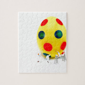 Miniature figurines painting yellow easter egg jigsaw puzzle