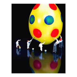 Miniature figurines painting yellow easter egg letterhead