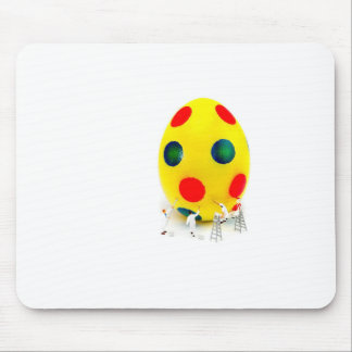 Miniature figurines painting yellow easter egg mouse pad