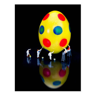 Miniature figurines painting yellow easter egg postcard