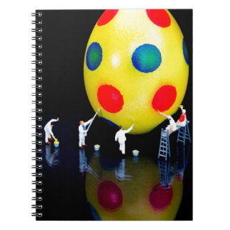 Miniature figurines painting yellow easter egg spiral notebook