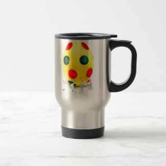 Miniature figurines painting yellow easter egg travel mug