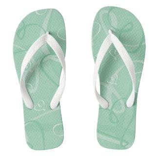 Mint green heart pattern flip flops
