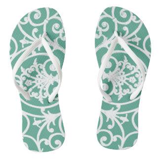 Mint green scrollwork pattern flip flops