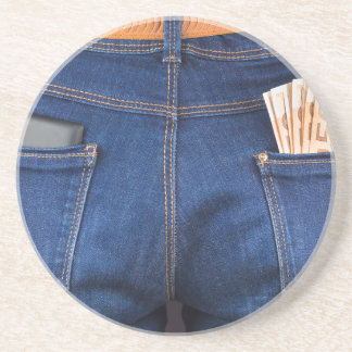 Mobile phone and euro money in blue jeans coaster