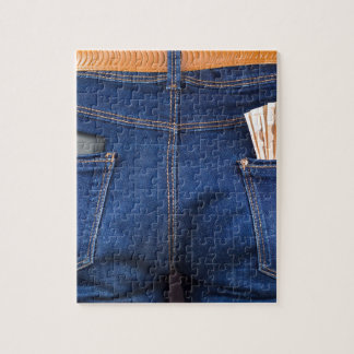 Mobile phone and euro money in blue jeans jigsaw puzzle