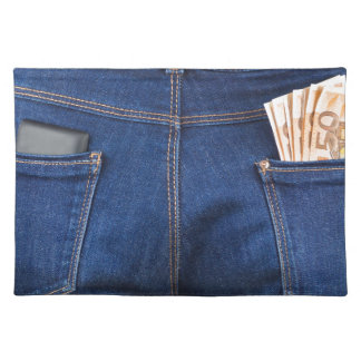 Mobile phone and euro money in blue jeans placemat