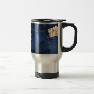 Mobile phone and euro money in blue jeans travel mug