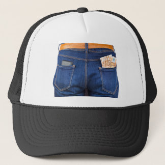 Mobile phone and euro money in blue jeans trucker hat