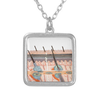 Model human skin tissue on white background silver plated necklace
