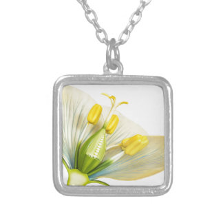Model of flower with stamens and pistils on white silver plated necklace