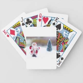 Model of Santa Claus standing in white snow Bicycle Playing Cards