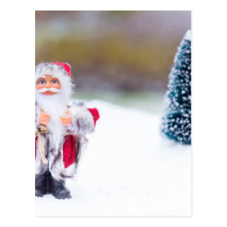 Model of Santa Claus standing in white snow Postcard