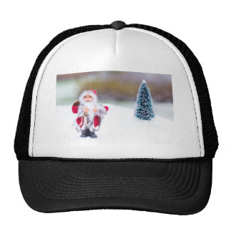 Model of Santa Claus standing in white snow Trucker Hat