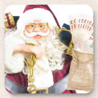 Model of Santa Claus with bell gifts and money Drink Coaster