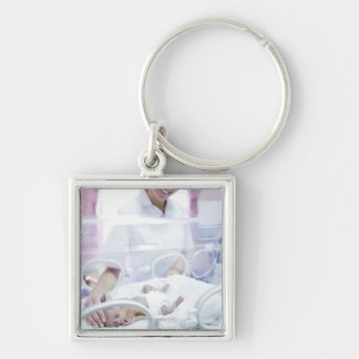 MODEL RELEASED. Nurse and premature baby. Silver-Colored Square Keychain