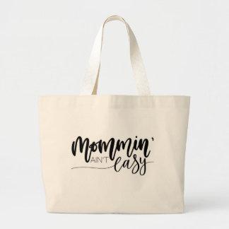 Mommin' ain't easy tote bag