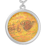 monarch butterfly and bicycle necklaces