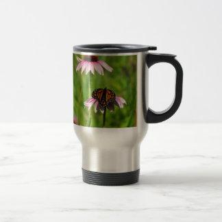 Monarch butterfly on a purple coneflower travel mug