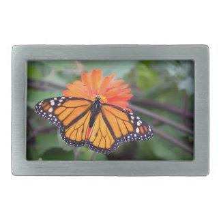 Monarch butterfly on orange flower rectangular belt buckle