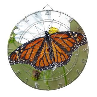 Monarch on Cosmos Dartboard With Darts