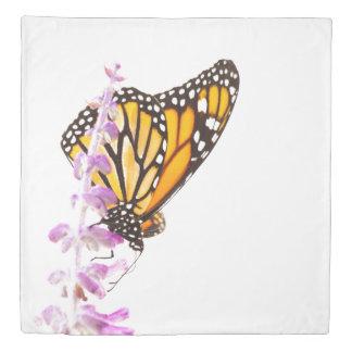 Monarch perched on lavender duvet cover