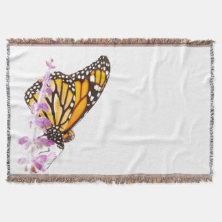 Monarch perched on lavender throw blanket