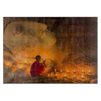 Monk Praying By A Buddha Boards