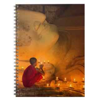 Monk Praying By A Buddha Notebooks