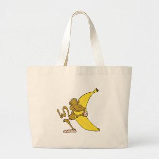 monkey hugging banana large tote bag