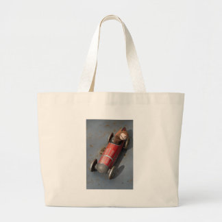 Monkey in a toy car large tote bag