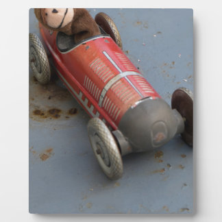 Monkey in a toy car plaque