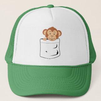 Monkey in pocket trucker hat