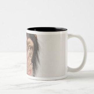 Monkey rubbing its face Two-Tone coffee mug
