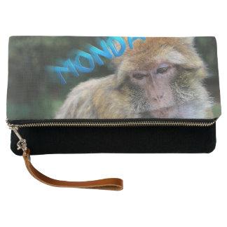Monkey sad about monday clutch