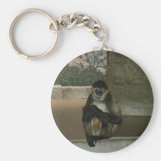 monkey sitting pretty basic round button keychain