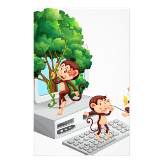 Monkeys playing and eating on computer screen stationery design