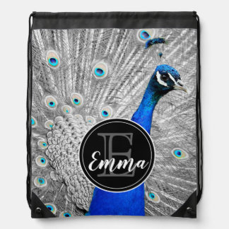 Monogram and photograph of white peacock feathers, drawstring bag