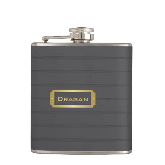 Monogram black and gold hip flask