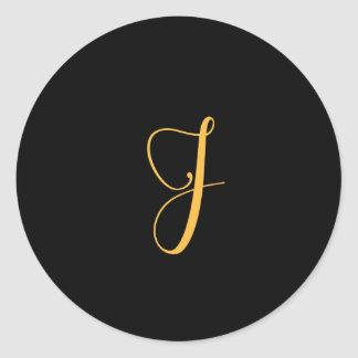 Monogram J gold on black background Classic Round Sticker