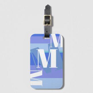 monogram on blue luggage tag