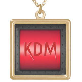 Monogram on red chrome effect, riveted steel frame gold plated necklace