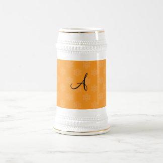 Monogram orange snowflakes coffee mugs