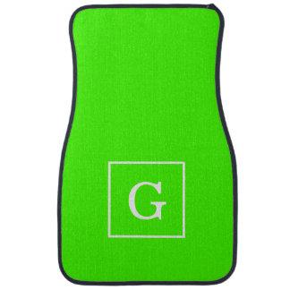 Monogramme initial encadré par blanc de vert de tapis de sol