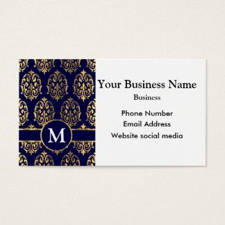 Monogrammed dark blue and gold damask business card